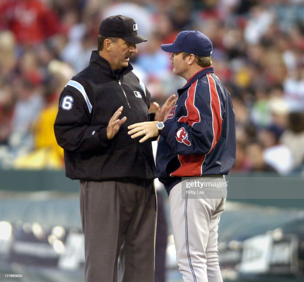 Cleveland Indians manager <a gi-track='captionPersonalityLinkClicked' href=/galleries/search?phrase=Eric+Wedge&family=editorial&specificpeople=214257 ng-click='$event.stopPropagation()'>Eric Wedge</a> argues with first base umpire <a gi-track='captionPersonalityLinkClicked' href=/galleries/search?phrase=Tim+McClelland&family=editorial&specificpeople=561877 ng-click='$event.stopPropagation()'>Tim McClelland</a> during 6-5 loss in 10 innings to the Los Angeles Angels of Anaheim at Angel Stadium in Anaheim, Calif. on Thursday, April 21, 2005.
