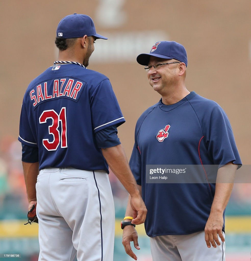 Cleveland Indians manager <a gi-track='captionPersonalityLinkClicked' href=/galleries/search?phrase=Terry+Francona&family=editorial&specificpeople=171936 ng-click='$event.stopPropagation()'>Terry Francona</a> #17 checks on the health of pitcher Danny Salazar #31 during the fourth inning after taking a line drive off the leg during the game at Comerica Park on September 1, 2013 in Detroit, Michigan.