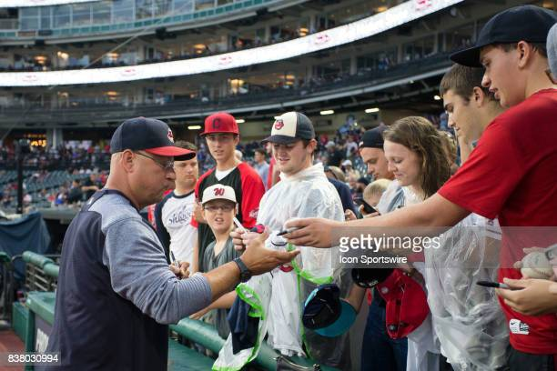 Cleveland Indians manager Terry Francona signs autographs for fans as the start of the Major League Baseball game between the Boston Red Sox and...