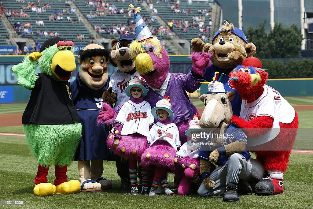 Cleveland Indians mascot Slider poses for a birthday photo with mascots from several other teams before the game against the Texas Rangers at Progressive Field on August 3, 2014 in Cleveland, Ohio.