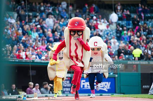 Cleveland Indians mascots Catchup Mustard and Onion run the hotdog race during the fifth inning of the game between the Detroit Tigers and Cleveland...