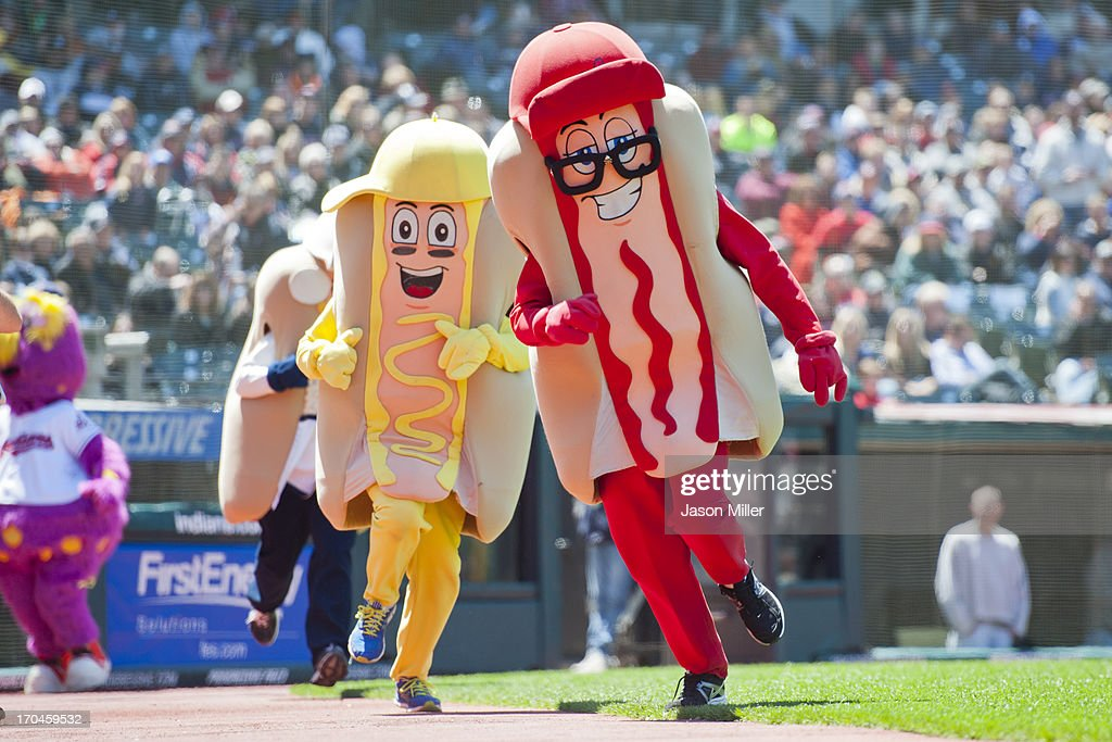 Cleveland Indians mascots Ketchup, Onion and Mustard race around the track during the first game of a doubleheader at Progressive Field on May 13, 2013 in Cleveland, Ohio.