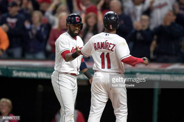 Cleveland Indians outfielder Austin Jackson greets Cleveland Indians second baseman Jose Ramirez at home plate after they both scored on the bases...