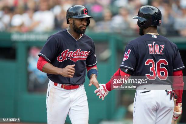 Cleveland Indians outfielder Austin Jackson is congratulated by Cleveland Indians third baseman Yandy Diaz after scoring a run during the third...
