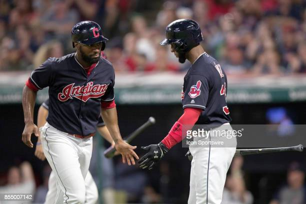 Cleveland Indians outfielder Austin Jackson is congratulated by Cleveland Indians third baseman Yandy Diaz after scoring on a throwing error by...
