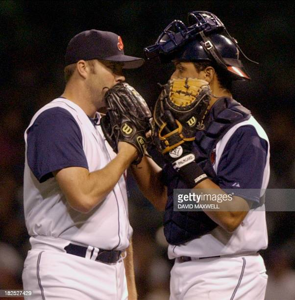 Cleveland Indians pitcher Dave Maurer and catcher Victor Martinez meet at the mound during the ninth inning against the Minnesota Twins on 14...