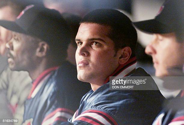 Cleveland Indians' pitcher Jaret Wright stares at the scoreboard after being pulled in the first inning against the New York Yankees in game one of...