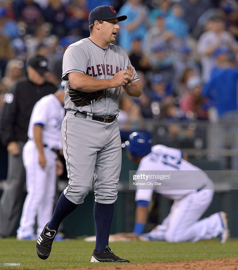 Cleveland Indians relief pitcher Bryan Shaw walks back to the mound after giving up the tying run on a single to the Kansas City Royals' Lorenzo Cain in the sixth inning on Wednesday, July 3, 2013, at Kauffman Stadium in Kansas City, Missouri.