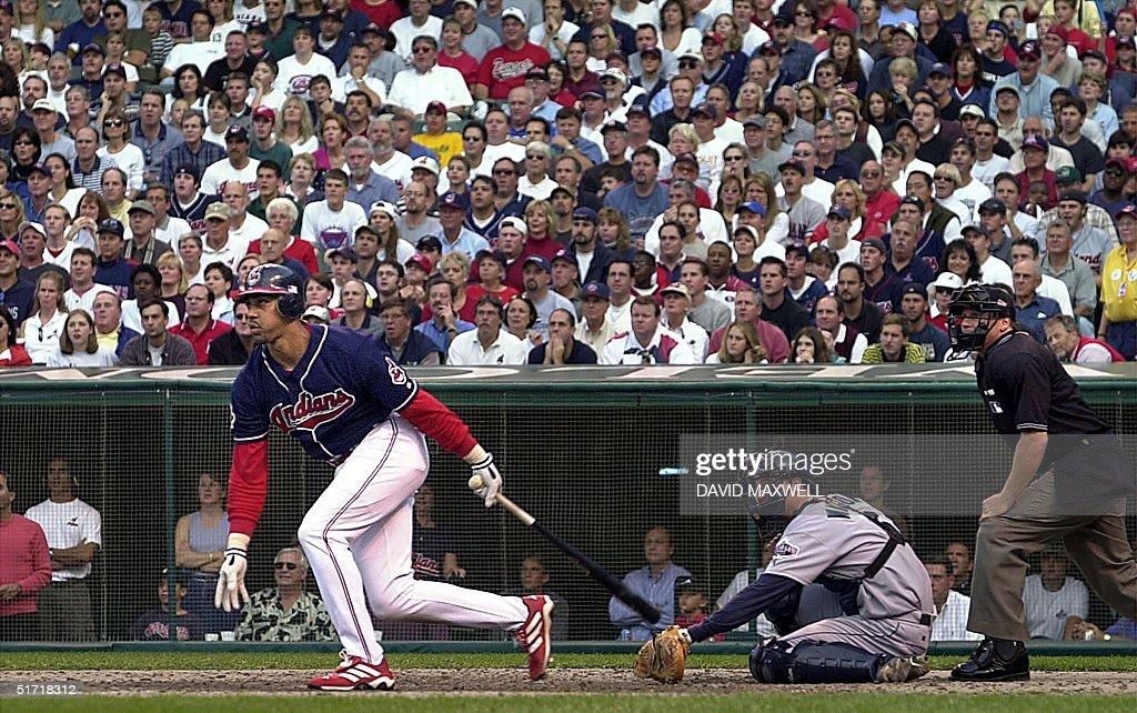 Cleveland Indians right fielder Juan Gonzalez Seattle Mariners catcher Dan Wilson and home plate umpire Paul Schrieber watch Gonzalez' leadoff home...