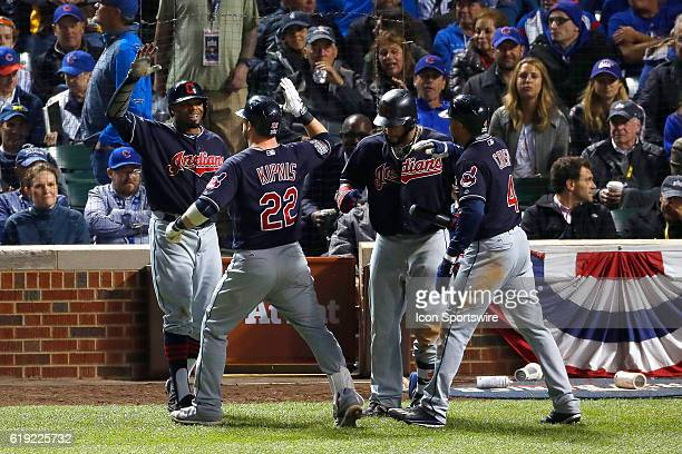 Cleveland Indians second baseman Jason Kipnis hits a threerun home run in the 7th inning and celebrates with Cleveland Indians center fielder Rajai...