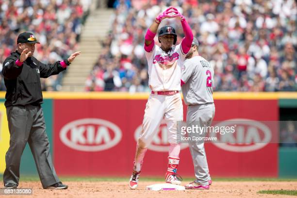 Cleveland Indians Shortstop Francisco Lindor signs to the Indians dugout after hitting a double during the third inning of the Major League Baseball...