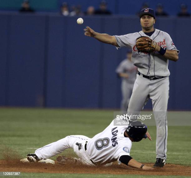 Cleveland Indians SS Jhonny Peralta throws over Toronto's Russ Adams to complete a double play vs the Toronto Blue Jays in MLB action at Rogers...
