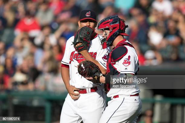 Cleveland Indians starting pitcher Carlos Carrasco and Cleveland Indians catcher Roberto Perez talk on the mound during the first inning of the Major...
