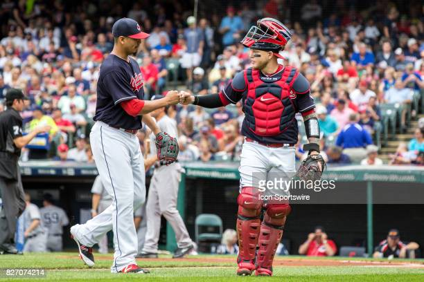 Cleveland Indians starting pitcher Carlos Carrasco and Cleveland Indians catcher Roberto Perez fist bump after the first inning of the Major League...