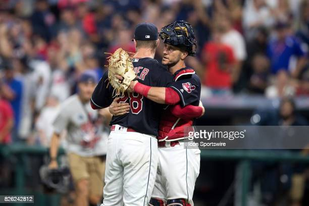 Cleveland Indians starting pitcher Corey Kluber and Cleveland Indians catcher Yan Gomes embrace following the Major League Baseball game between the...