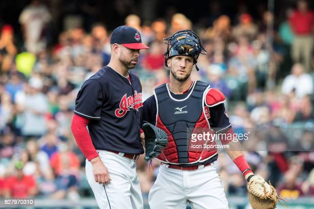 Cleveland Indians starting pitcher Corey Kluber and Cleveland Indians catcher Yan Gomes leave the field following the first inning of the Major...