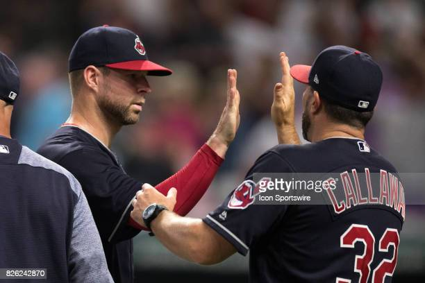 Cleveland Indians starting pitcher Corey Kluber gets a high five from Cleveland Indians pitching coach Mickey Callaway following the Major League...