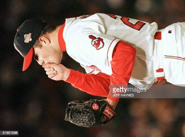 Cleveland Indians starting pitcher Jaret Wright warms his hand against the Florida Marlins 22 October in game 4 of the World Series at Jacobs Field...