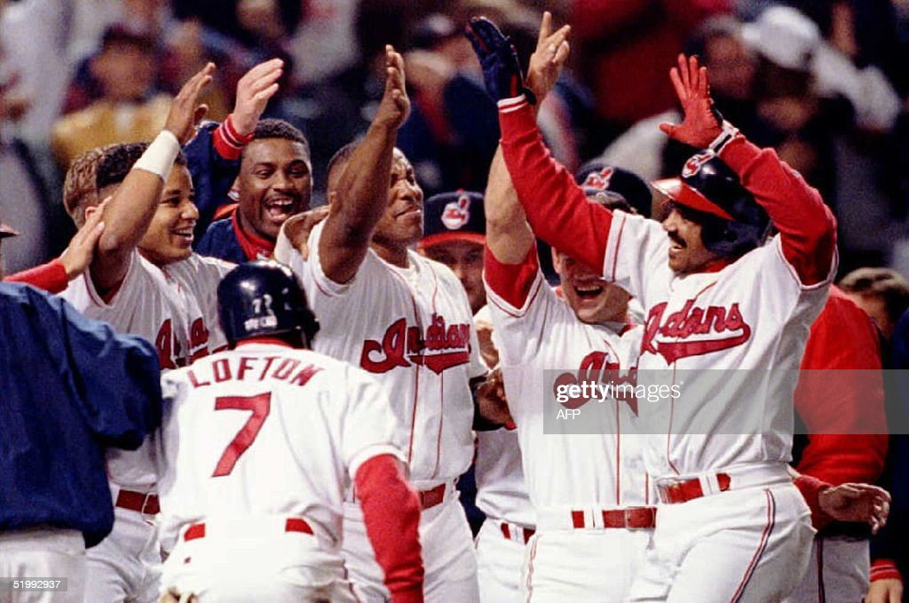 Cleveland Indians Tony Pena is met by celebrating teammates as he crosses home plate after hitting the gamewinning home run in the 13th inning to...