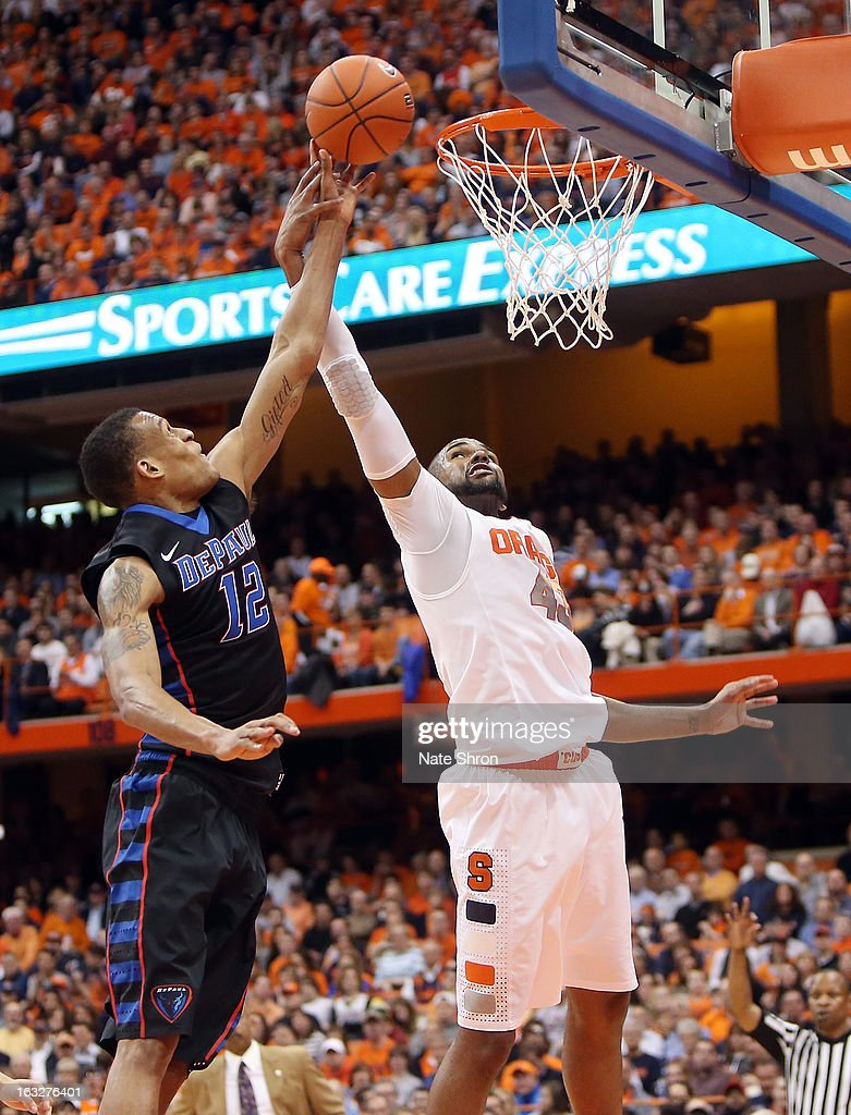 Cleveland Melvin #12 of the DePaul Blue Demons goes up for a shot against James Southerland #43 of the Syracuse Orange during the game at the Carrier Dome on March 6, 2013 in Syracuse, New York.