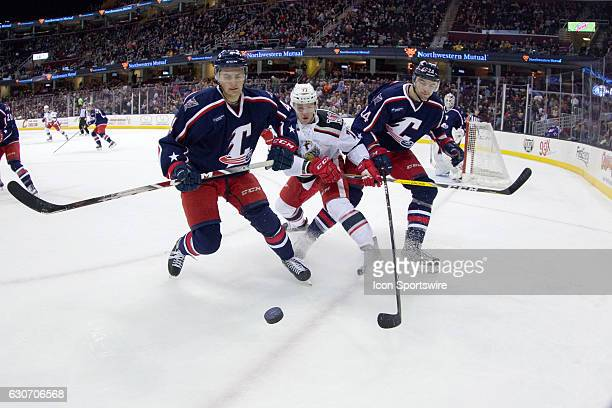 Cleveland Monsters D Blake Siebenaler Grand Rapids Griffins RW Evgeny Svechnikov and Cleveland Monsters D Oleg Yevenko follow the puck into the...