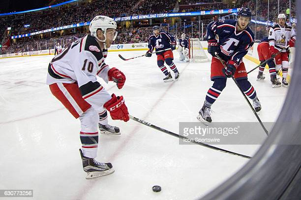 Cleveland Monsters D Dean Kukan attempts to clear the puck against Grand Rapids Griffins C Ben Street during the first period of the AHL hockey game...