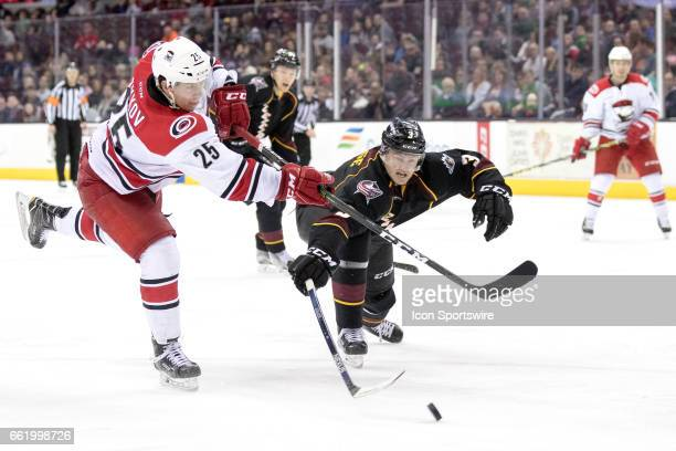 Cleveland Monsters D Scott Savage defends against Charlotte Checkers RW Valentin Zykov during the third period of the AHL hockey game between the...