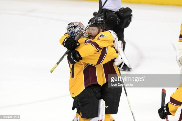 Cleveland Monsters G Anton Forsberg and Cleveland Monsters LW Nick Moutrey celebrate following the AHL hockey game between the Grand Rapids Griffins...