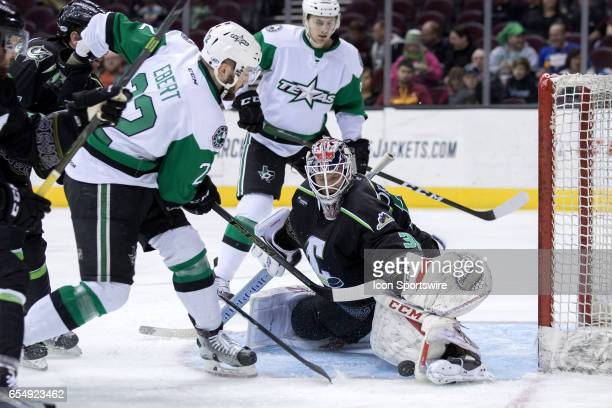 Cleveland Monsters G Anton Forsberg makes a save on Texas Stars D Nick Ebert during the first period of the AHL hockey game between the Texas Stars...