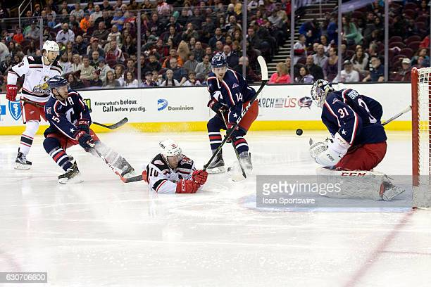 Cleveland Monsters G Anton Forsberg makes a save on the shot of a diving Grand Rapids Griffins C Ben Street as cle5 and Cleveland Monsters D Dean...