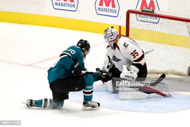 Cleveland Monsters goalie Matiss Kivlenieks makes a save against San Jose Barracuda left wing Marcus Sorensen during the overtime period of the...