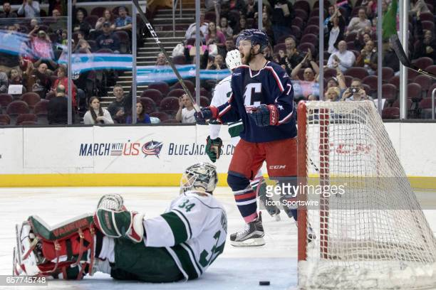 Cleveland Monsters LW Nick Moutrey celebrates after scoring a goal against Iowa Wild G Steve Michalek during the second period of the AHL hockey game...