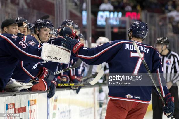 Cleveland Monsters LW Nick Moutrey is congratulated by teammates after scoring a goal during the second period of the AHL hockey game between the...