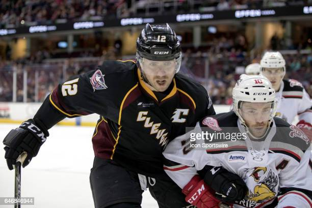 Cleveland Monsters LW Ryan Craig and Grand Rapids Griffins C Ben Street follow the puck into the corner during the second period of the AHL hockey...