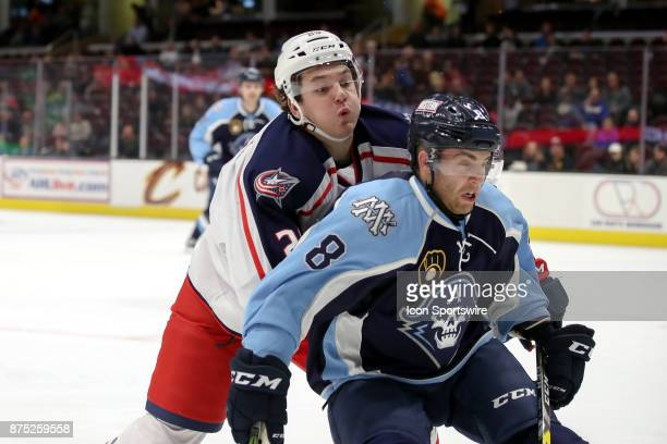 Cleveland Monsters right wing Hayden Hodgson takes Milwaukee Admirals defenceman Trevor Murphy into the boards during the second period of the...