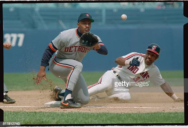 Joe Carter of Cleveland slides safely into 3rd base ahead to throw to Detroit 3rd baseman Chris Brown Action took place in the 5th inning as Carter...