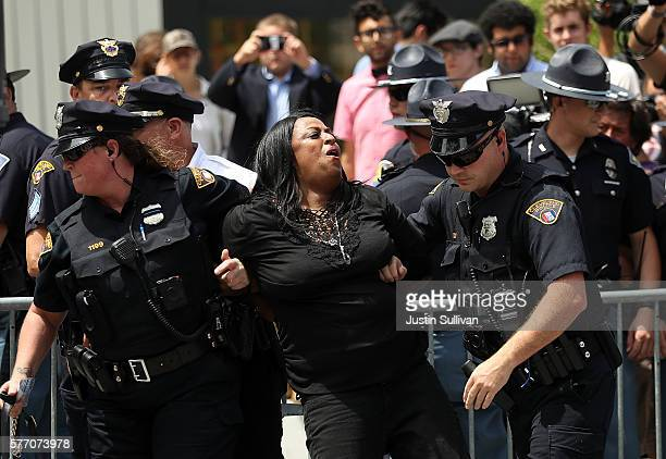 Cleveland police officers detain a protester in Cleveland Public Square near the site of the Republican National Convention on July 18 2016 in...