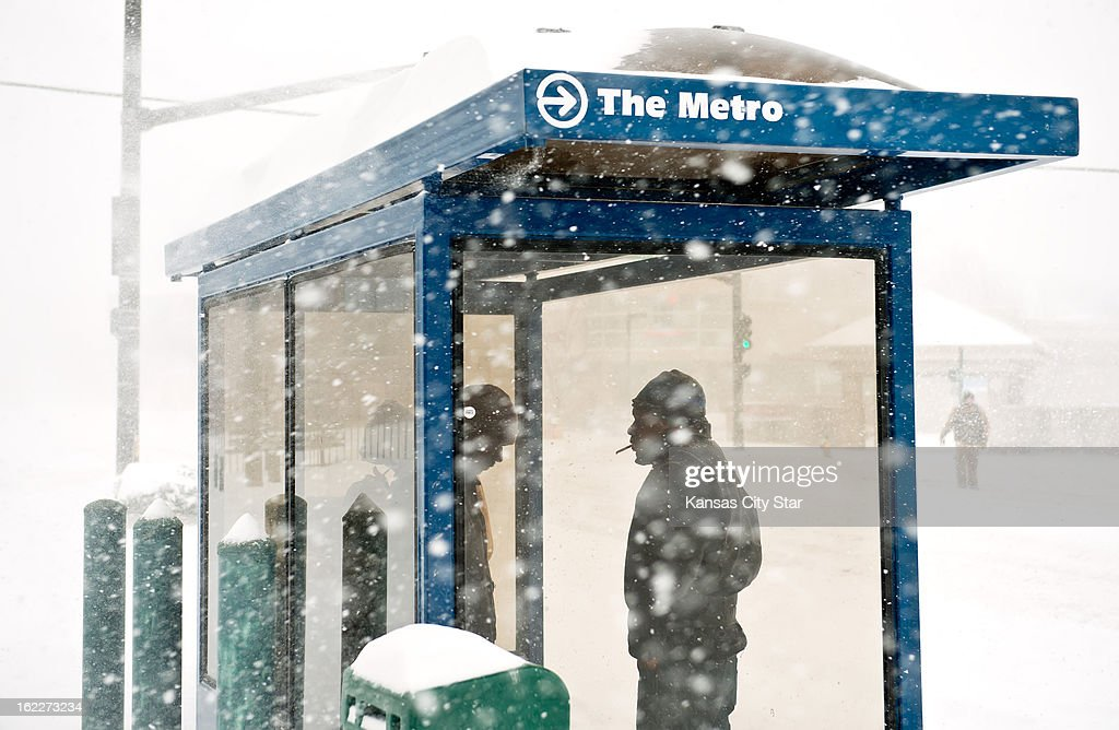 Cleveland Porter of Kansas City, Missouri waits inside a Metro bus shelter at 39th & Broadway in Kansas City, for his bus which he had been waiting 45 minutes for during heavy snowfall that blanketed the metro area, Thursday, February 21, 2013.