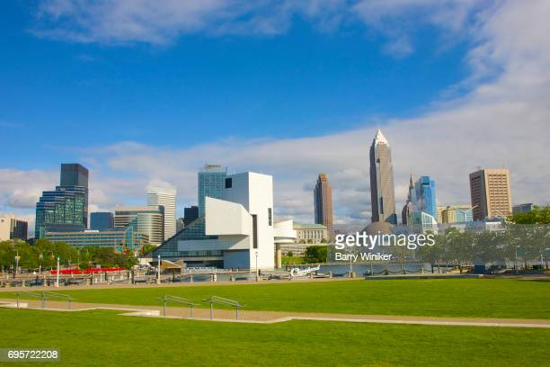 Cleveland skyline above green lawn of Voinovich Park