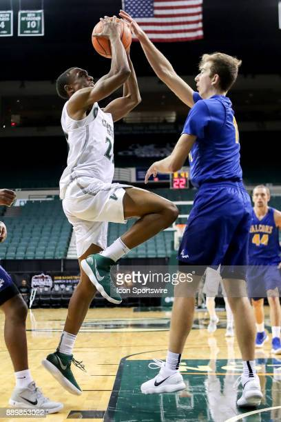 Cleveland State Vikings Bobby Word drives to the basket as Notre Dame College Falcons guard Cole Hayes defends during the first half of the men's...