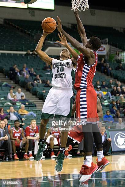 Cleveland State Vikings G Bobby Word goes up for a shot against UIC Flames F/C Clint Robinson during the first half of the NCAA Men's Basketball game...