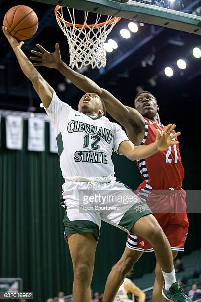 Cleveland State Vikings G Kasheem Thomas shoots as UIC Flames F/C Tai Odiase defends during the second half of the NCAA Men's Basketball game between...