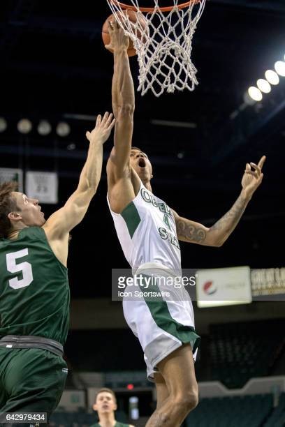 Cleveland State Vikings G/F Anthony Wright scores as Wright State Raiders G Mike La Tulip defends during the first half of the men's college...