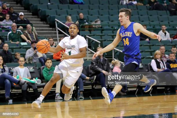 Cleveland State Vikings Kasheem Thomas drives to the basket past Notre Dame College Falcons forward Angelo Cugini during the second half of the men's...