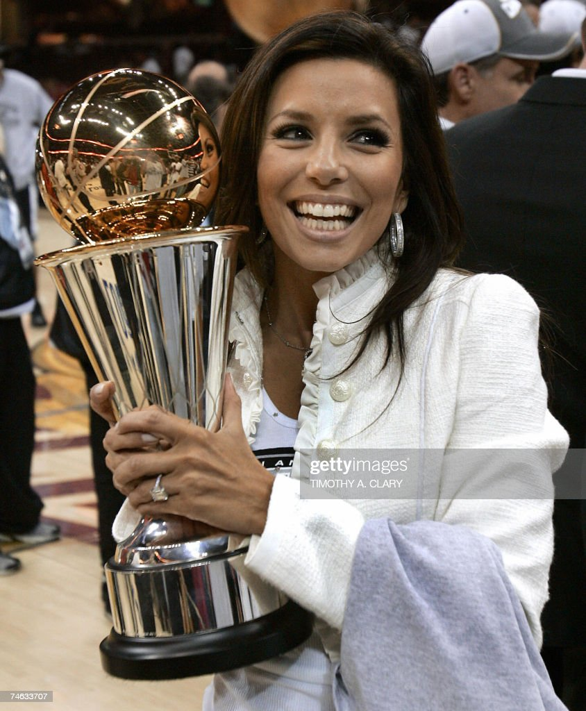 Actress Eva Longoria holds the MVP Trophy of her fiance Frenchman Tony Parker of the San Antonio Spurs after he lead the San Antonio Spurs to their fourth NBA title beating the Cleveland Cavaliers 14 June 2007 in Game Four of the NBA Finals at Quicken Loans Arena in Cleveland, Ohio. The Spurs won the game 83-82 to sweep the best-of-seven series 4-0.