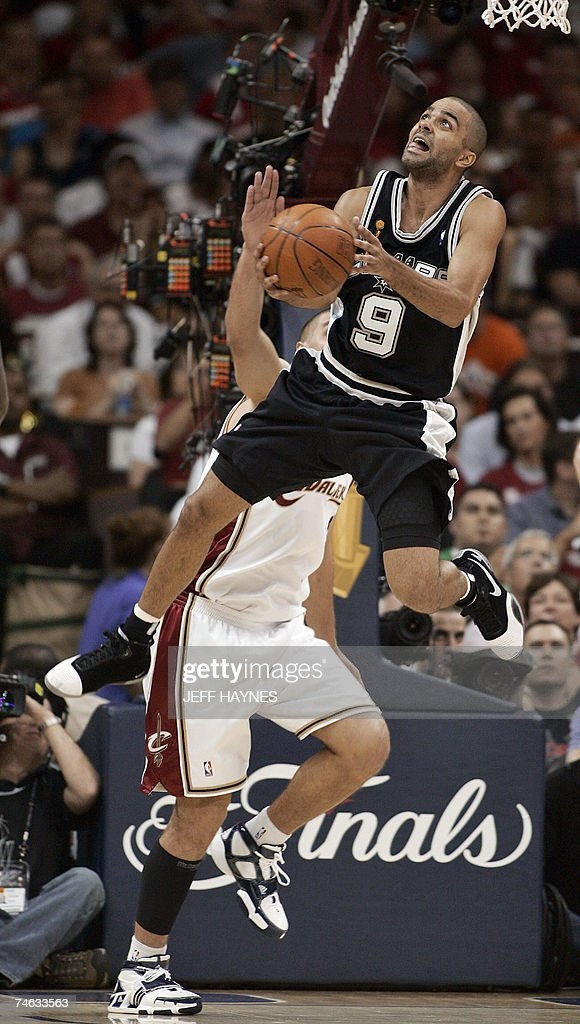 Series MVP Frenchman Tony Parker of the San Antonio Spurs shoots against Sasha Pavlovic of the Cleveland Cavaliers during Game Four of the NBA Finals 14 June 2007 at Quicken Loans Arena in Cleveland, Ohio. The Spurs won the game 83-82 to sweep the best-of-seven series 4-0.