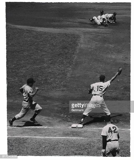Cleveland's Al Rosen is forced out at second on Dave Philley's grounder to shortstop Phil Rizzuto who threw to second baseman Gerry Coleman who...
