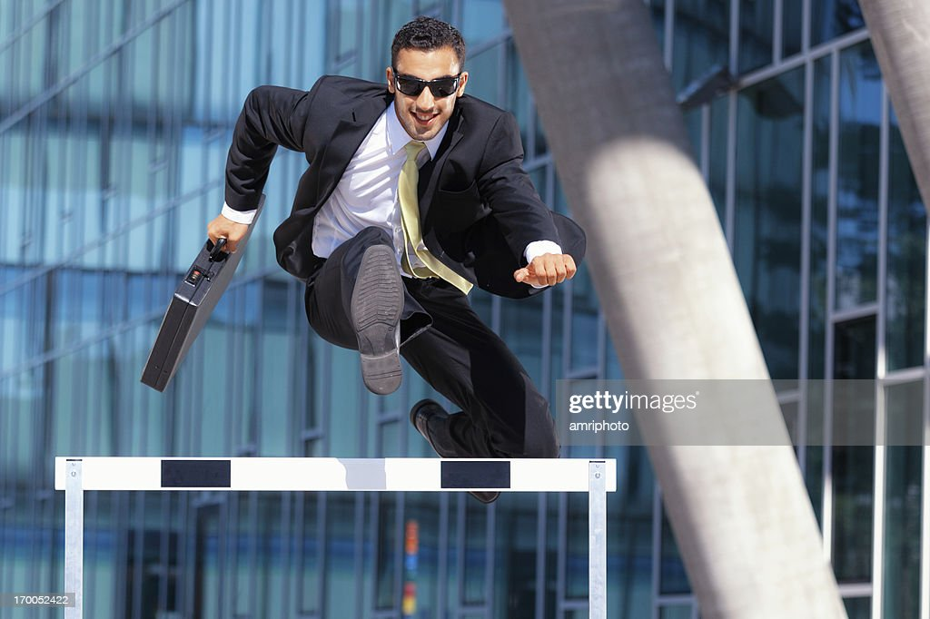 clever dynamic business hurdler : Stock Photo