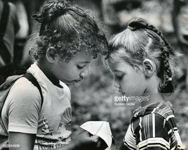 Clicia Cox left and Josephine Barreiro both of Boston played the fortune teller questionandanswer folding paper game at Camp Ponkawissett on August...