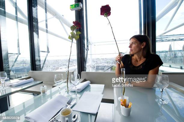 A client enjoys a glass of water in restaurant Georges in Paris France on November 7 2013 Restaurant Le Georges is one of the two trendy Parisian...